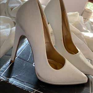 White heels with minor marks